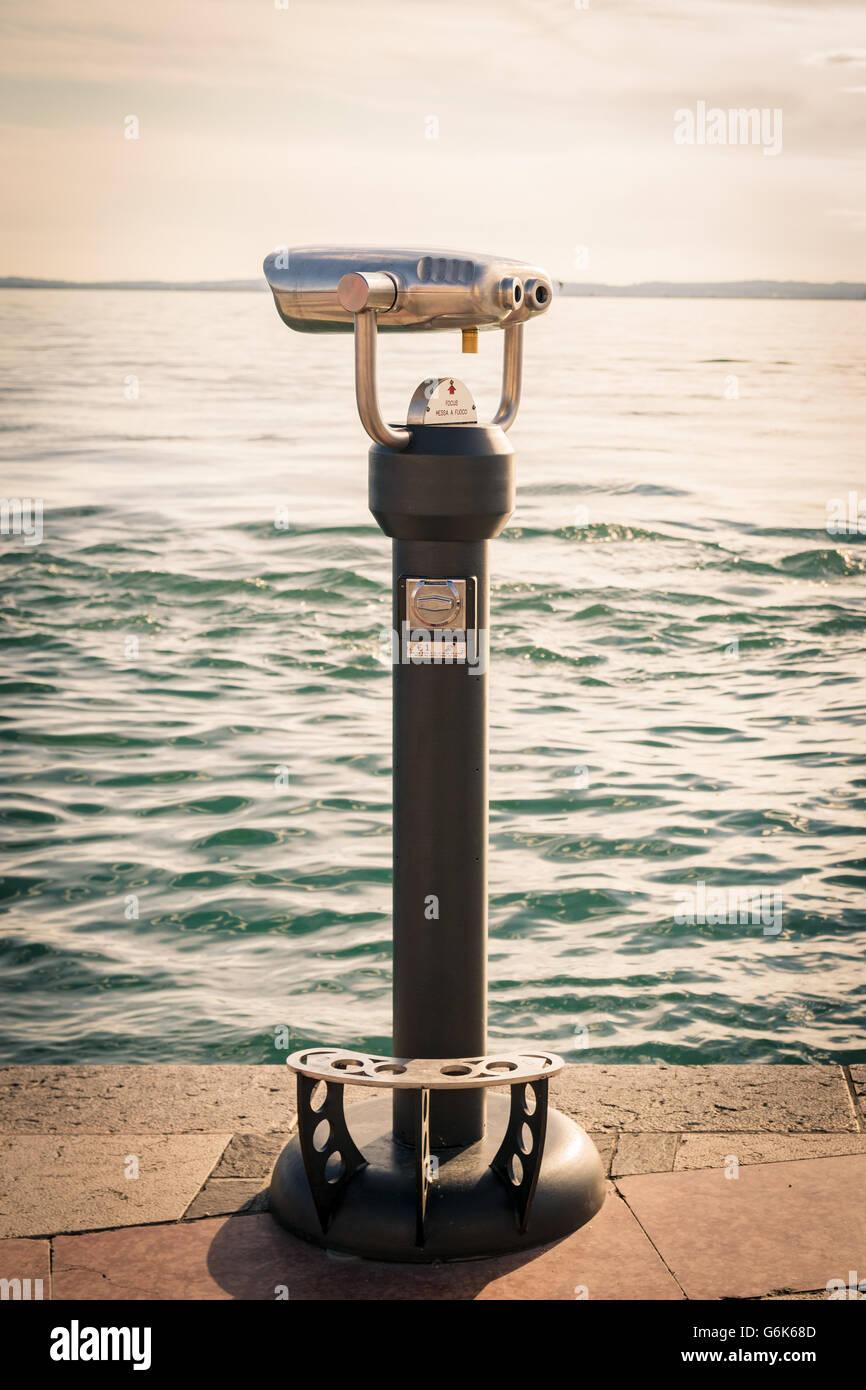 Coin Operated Binocular viewer next to the waterside promenade in Lazise, lake Garda, Italy. - Stock Image