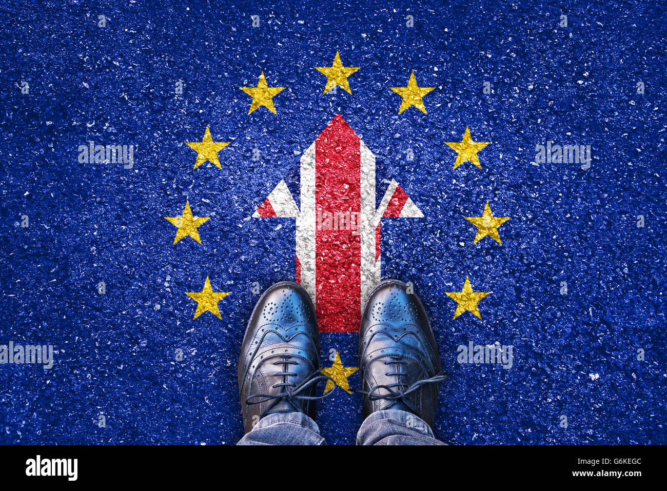 Brexit, flags of the United Kingdom and the European Union on asphalt road with legs - Stock Image