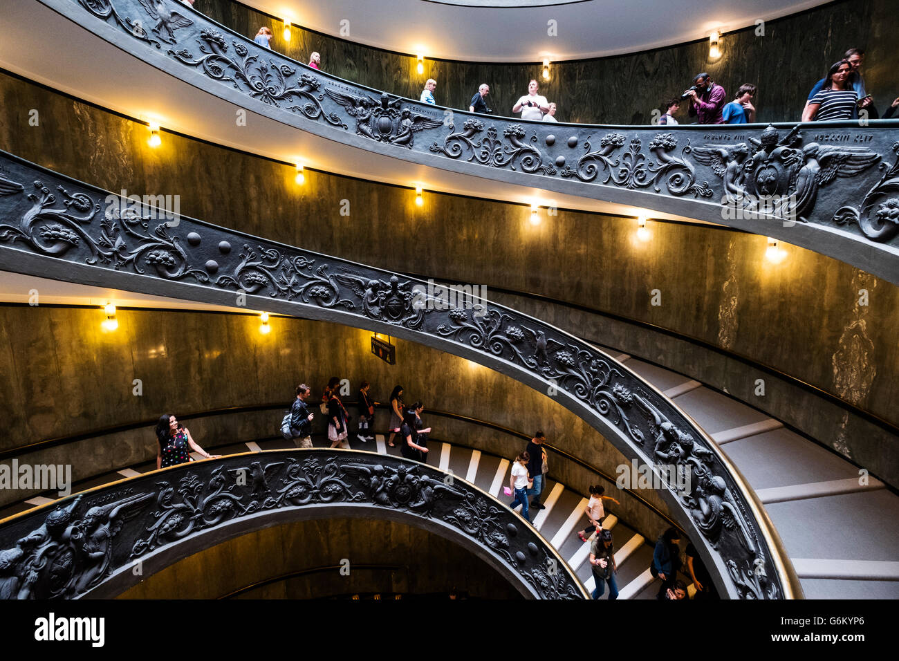 Visitors descend the famous spiral staircase in the  Vatican Museum in Rome, Italy - Stock Image