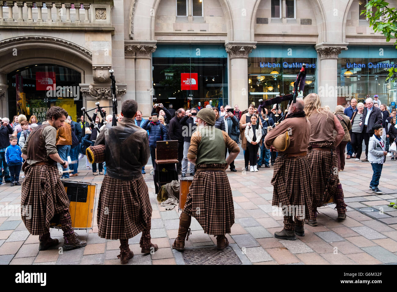 Scottish street buskers in kilts playing traditional music on Buchanan Street in Glasgow Scotland United Kingdom - Stock Image