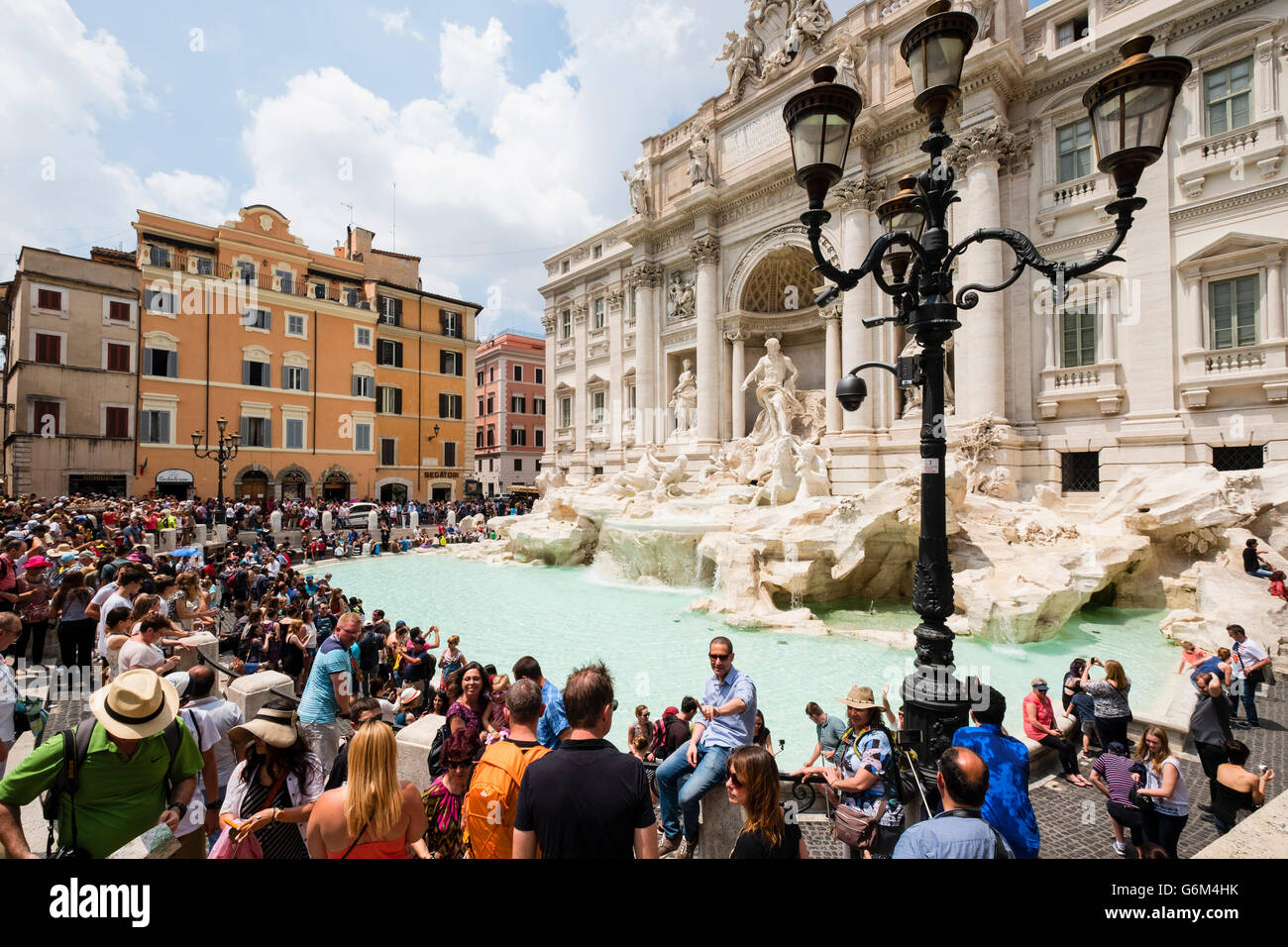 Trevi Fountain or Fontana di Trevia with many tourists in Rome Italy - Stock Image