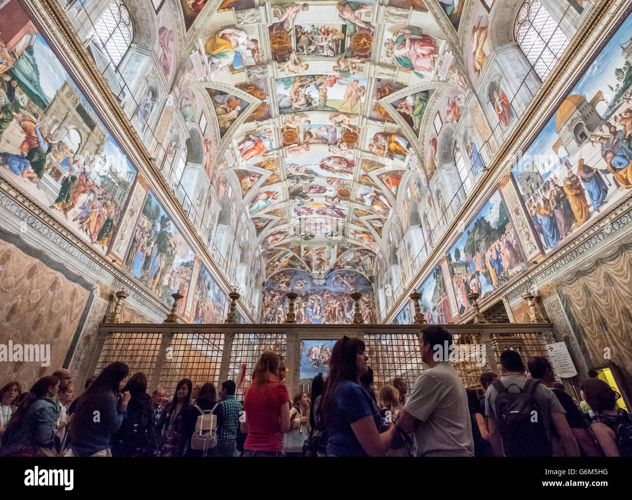 tourists looking at ceiling in Sistine Chapel in the Vatican Museum in Rome, Italy - Stock Image