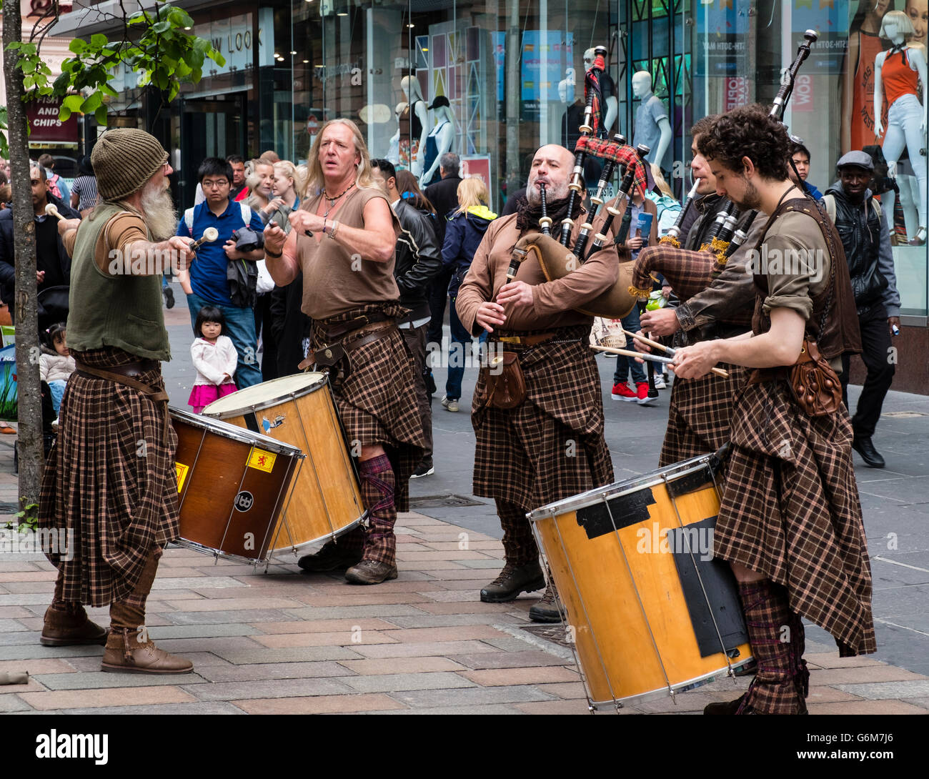 Scottish street buskers playing traditional music on Buchanan Street in Glasgow Scotland United Kingdom - Stock Image