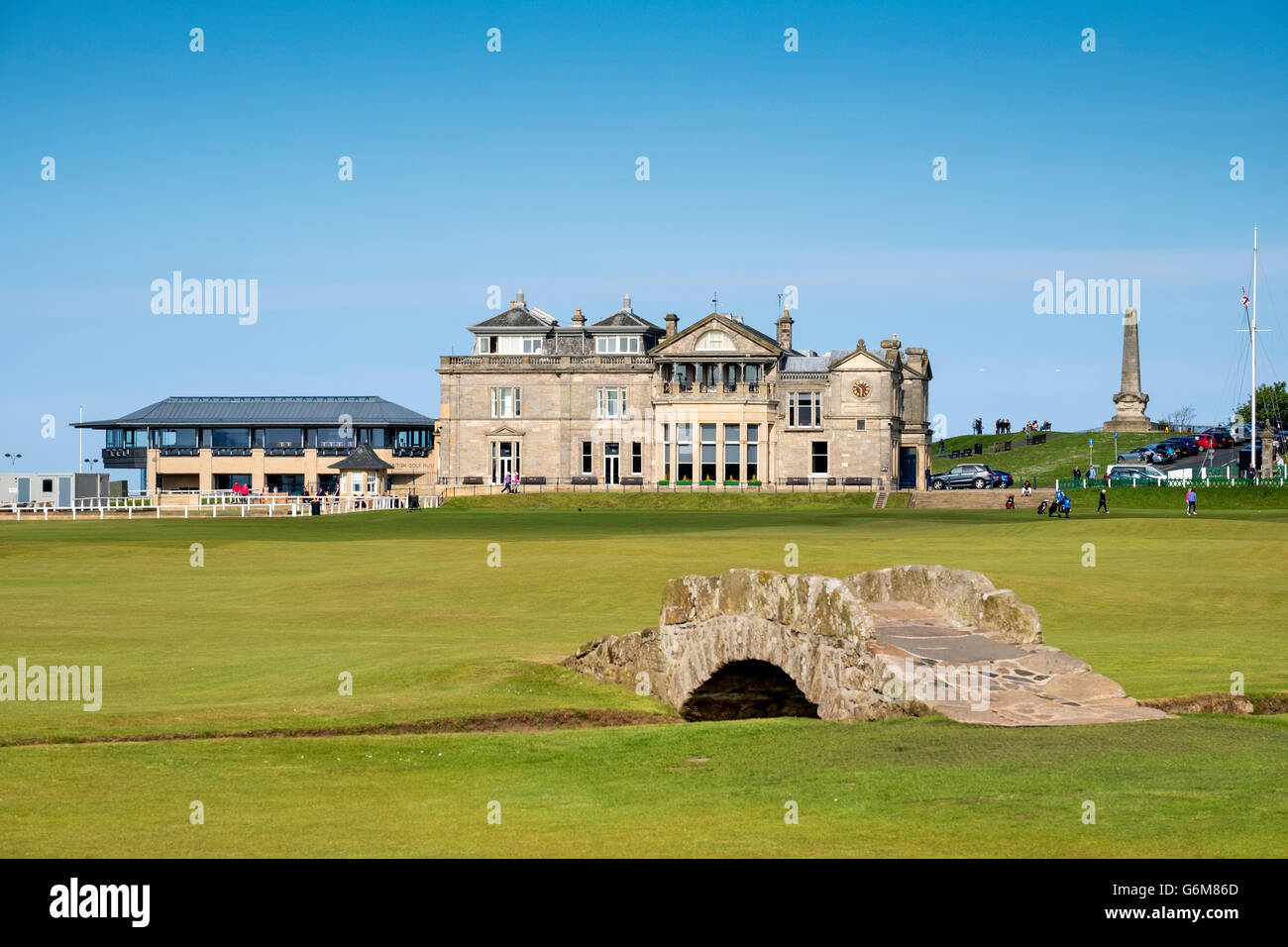 View of Clubhouse and Swilken Burn Bridge on fairway of 18th hole, tom, morris,at Old Course in St Andrews in Fife - Stock Image