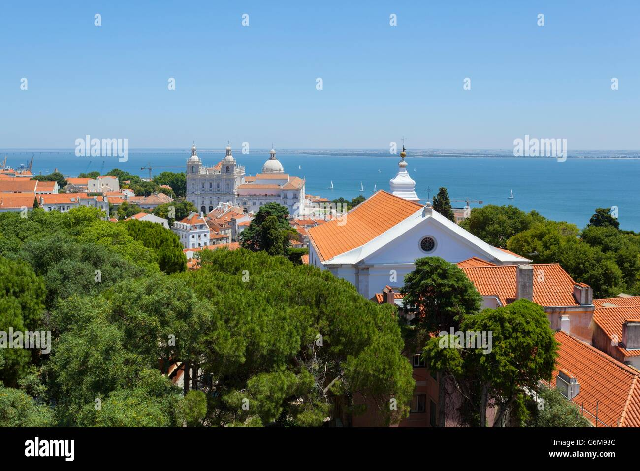 View over the Alfama district and the Tagus river shot from the Castelo de Sao Jorge - Stock Image