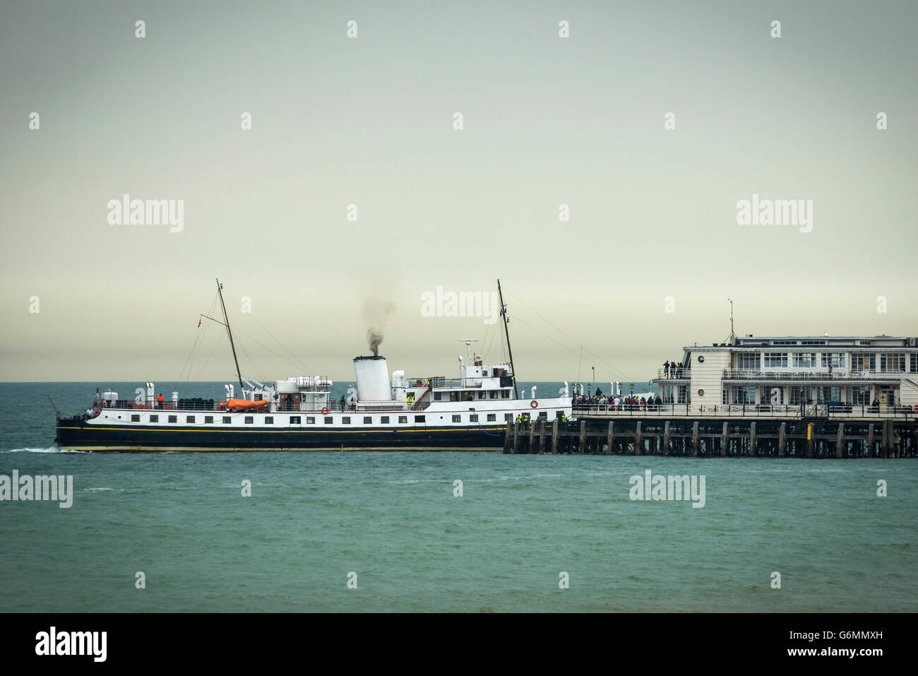 The MV Balmoral arriving at Worthing Pier on an English Channel excursion. - Stock Image