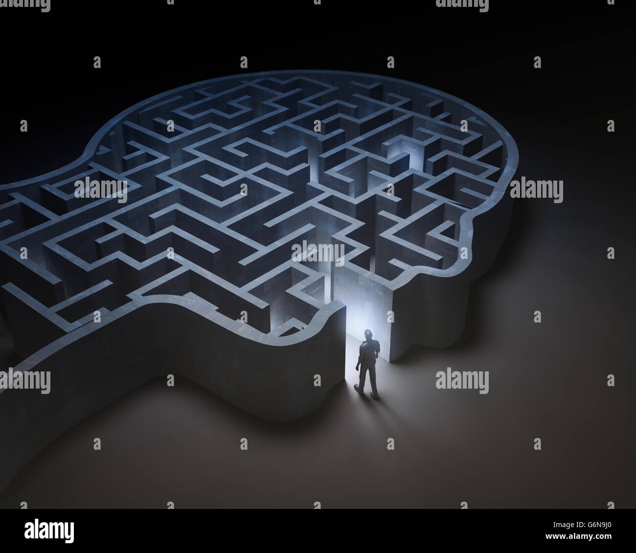 Man entering a maze inside a head - 3D illustration - Stock Image
