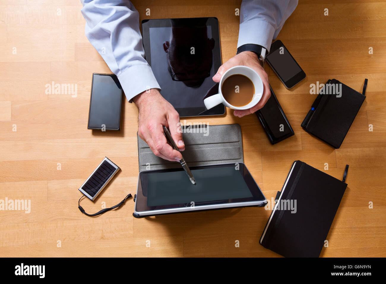 Overhead view of businessman using technology - Stock Image