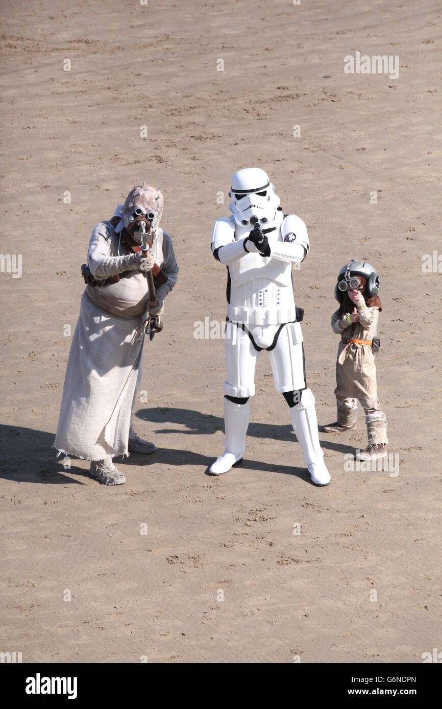Startrooper with Sci-Fi Family posing on beach at Sci-fi convention. - Stock Image