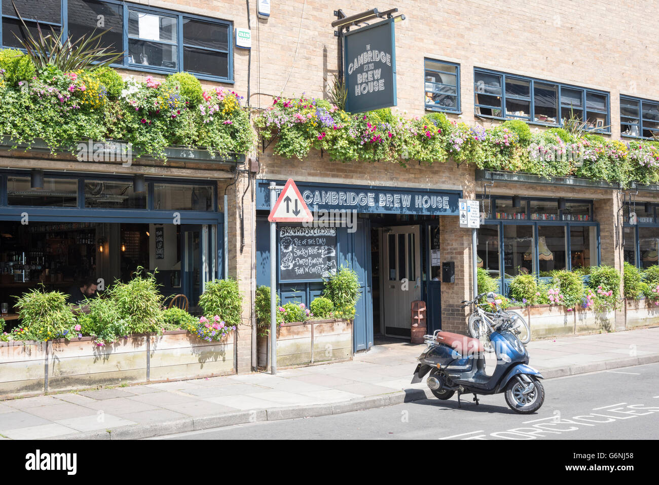 The Cambridge Brew House pub and restaurant King Street Cambridge UK with pretty window boxes outside - Stock Image