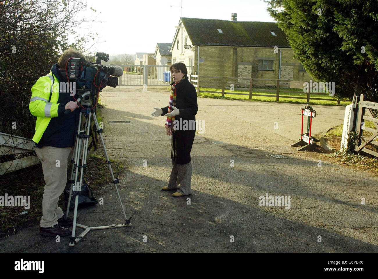 A TV crew stand at Cambridge University - Stock Image