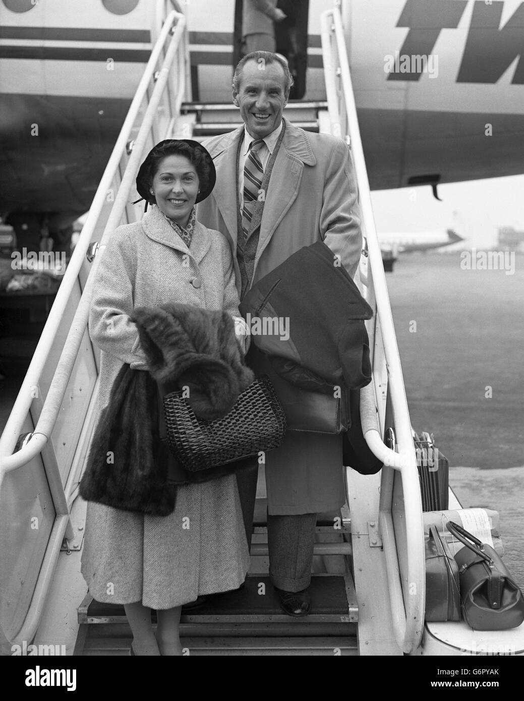 Tennis - Fred Perry with wife Barbara - London Airport - Stock Image