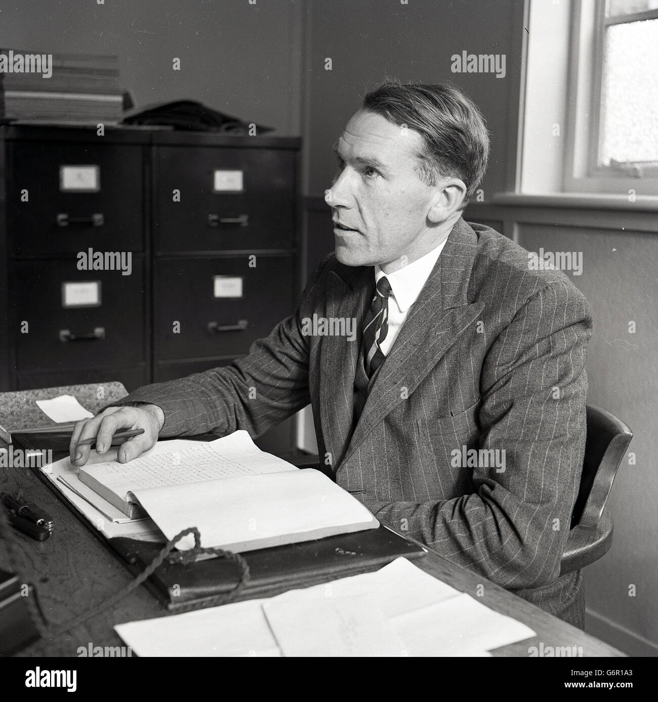 1950s, historical, a senior executive in British industry in his office at his desk with paperwork, ink blotter Stock Photo