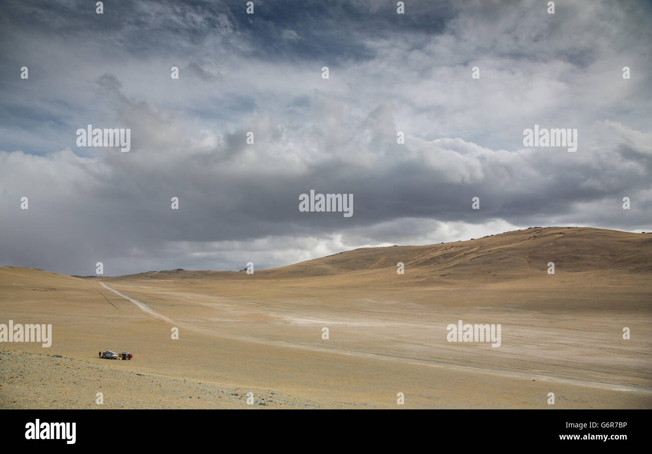 Higway to West with two cars parked on the side of a road - Stock Image