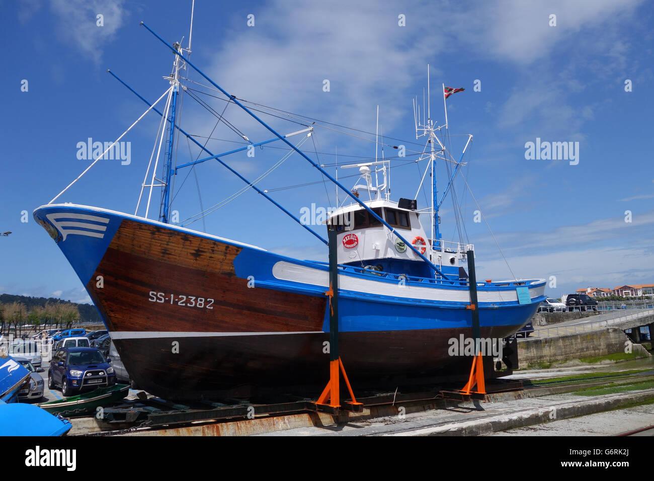 Tuna fishing boat vessel ship in dry dock in Hondarribia in Gipuzkoa, Basque Country, Spain - Stock Image