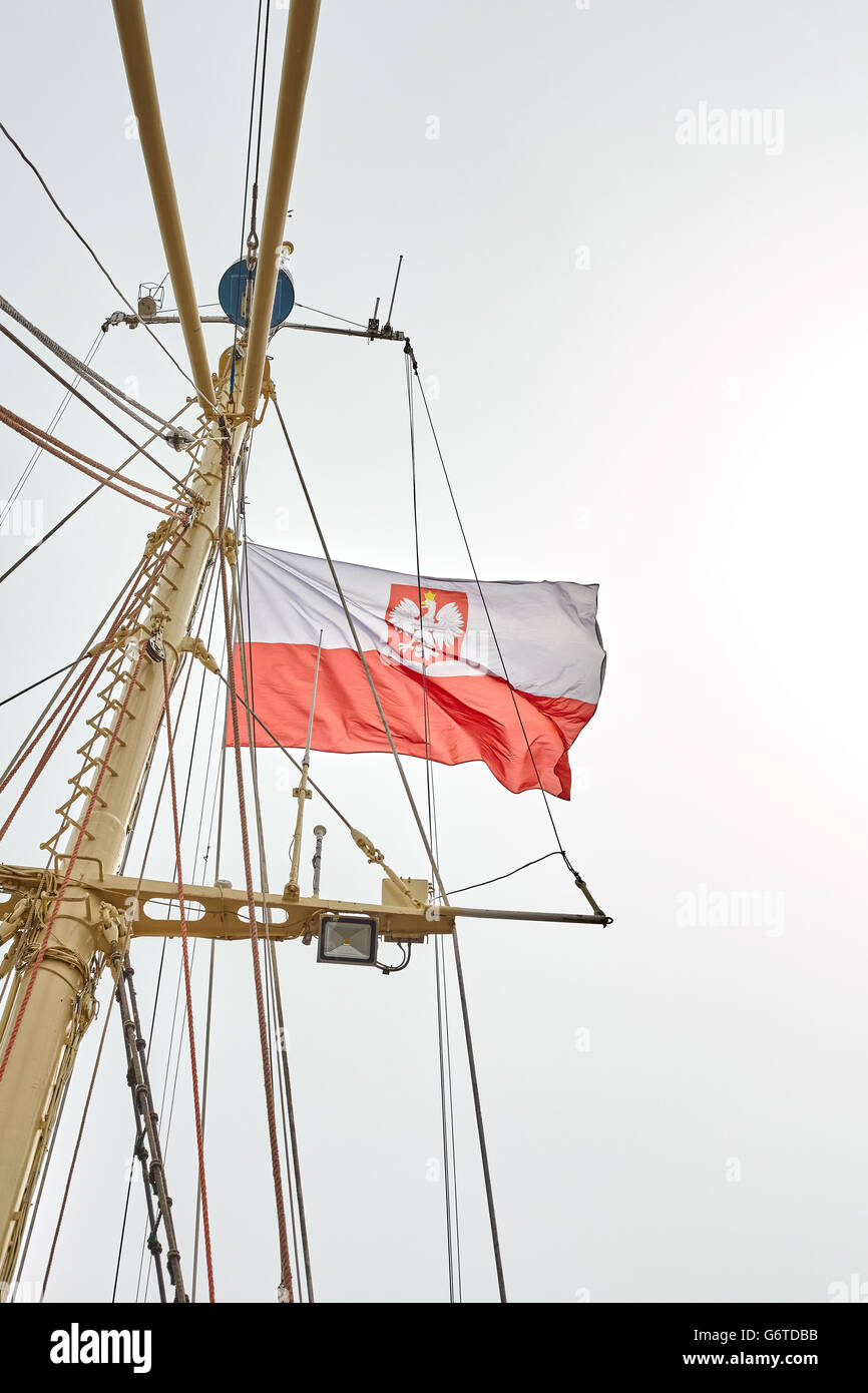 Polish flag on a sailing ship flagpole. Stock Photo