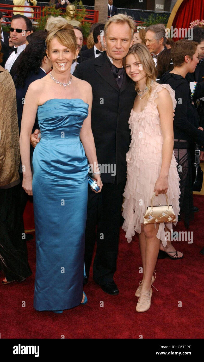 Singer Sting arrives with his wife Tudie Styler and daughter Coco at the Kodak Theatre in Los Angeles for the 76th Academy Awards. Sting is wearing a Chopard diamond cravat pin and matching cufflinks. Stock Photo