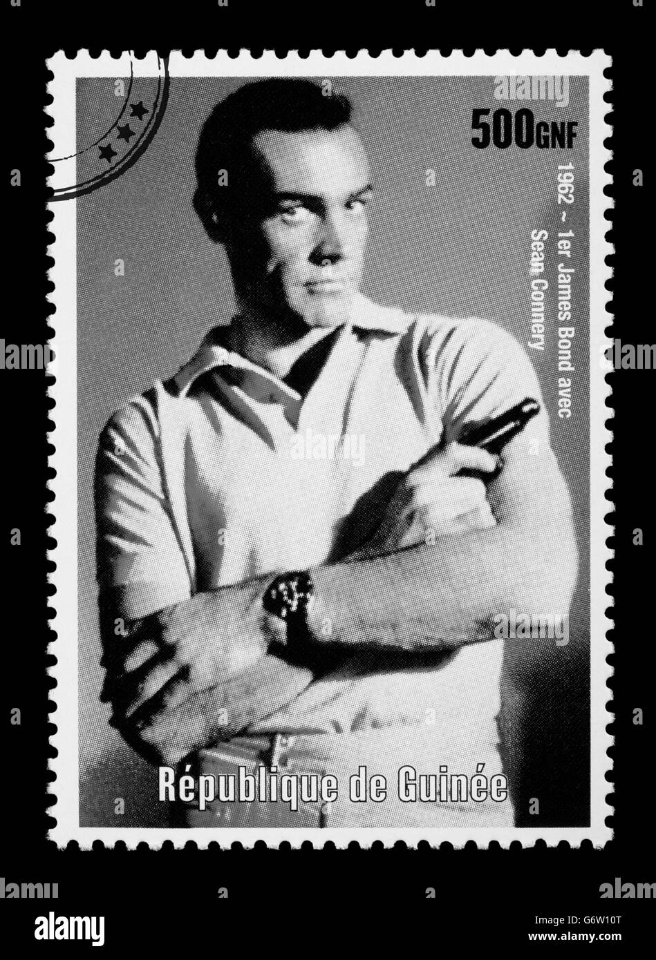A postage stamp printed in the Republic of Guinea showing James Bond - Stock Image