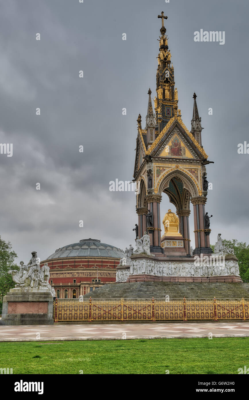 Albert Memorial in Kensington Gardens with the Royal Albert Hall in the background. HDR image - Stock Image