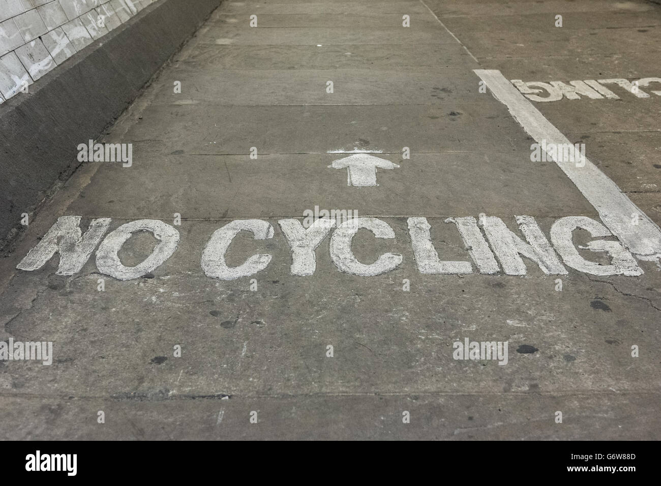 No cycling sign written on floor of Greenwich Tunnel in London, United Kingdom - Stock Image