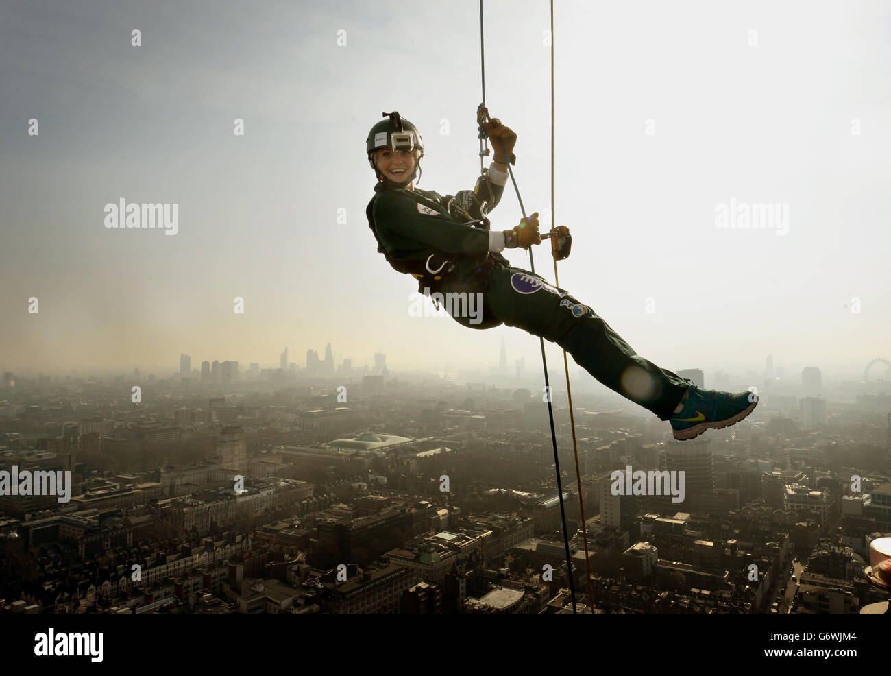 Charity abseil down the BT Tower - Stock Image