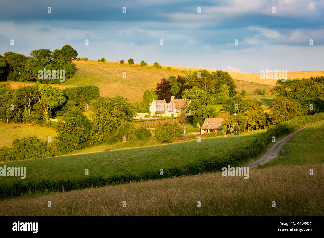 Evening sunlight over Cotswolds cottages near Snowshill, Gloucestershire, England - Stock Image