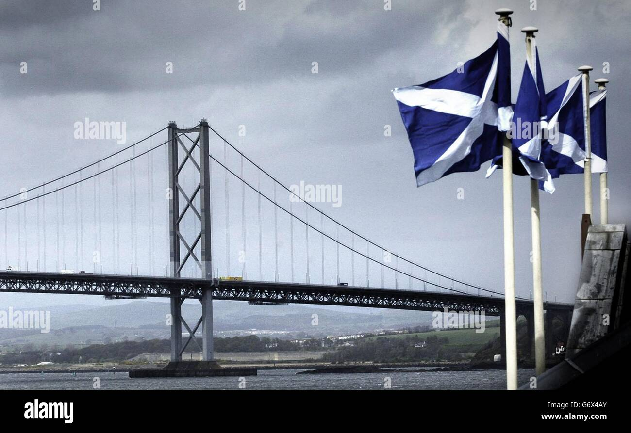 Scottish flags fly in front of the Forth Road Bridge Stock Photo