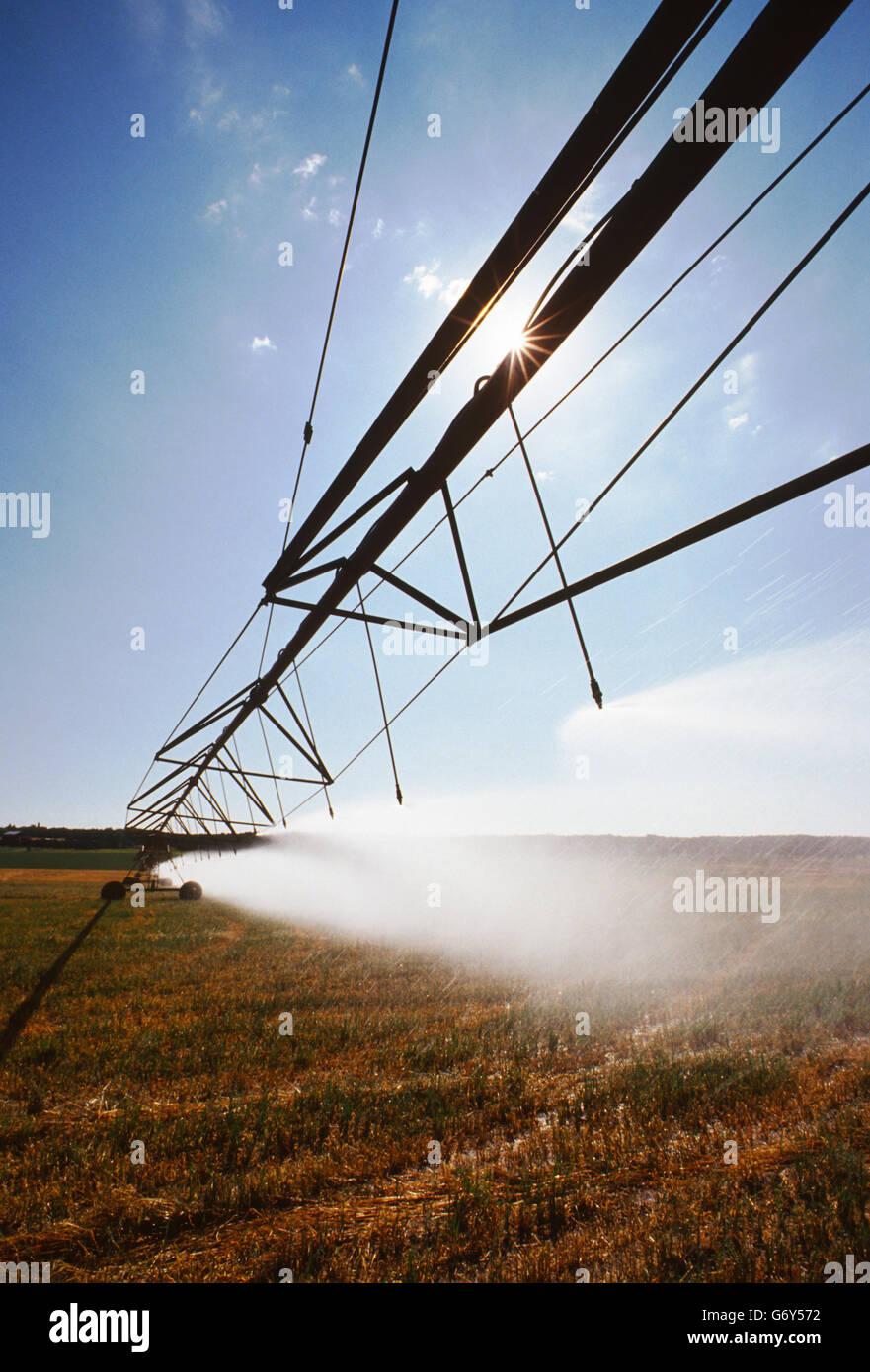 Irrigation equipment spraying water on farm fields near Cortez, Colorado, USA - Stock Image