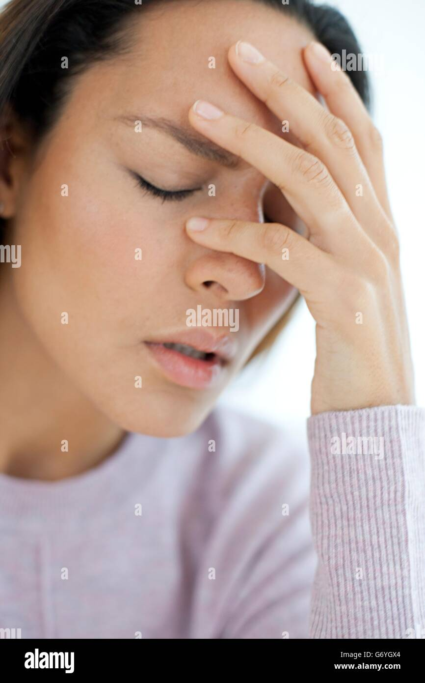 MODEL RELEASED. Young woman feeling unwell. - Stock Image