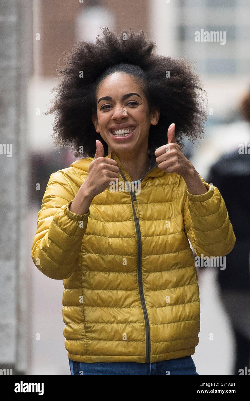 Pearl Mackie, the Doctor's assistant, spotted during filming for Doctor Who in Cardiff, South Wales. - Stock Image