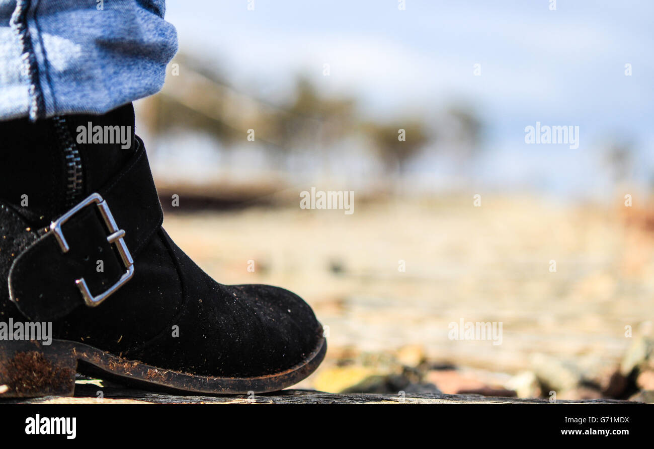 Close up of  a boot walking along the railway lines on a foggy morning - Stock Image