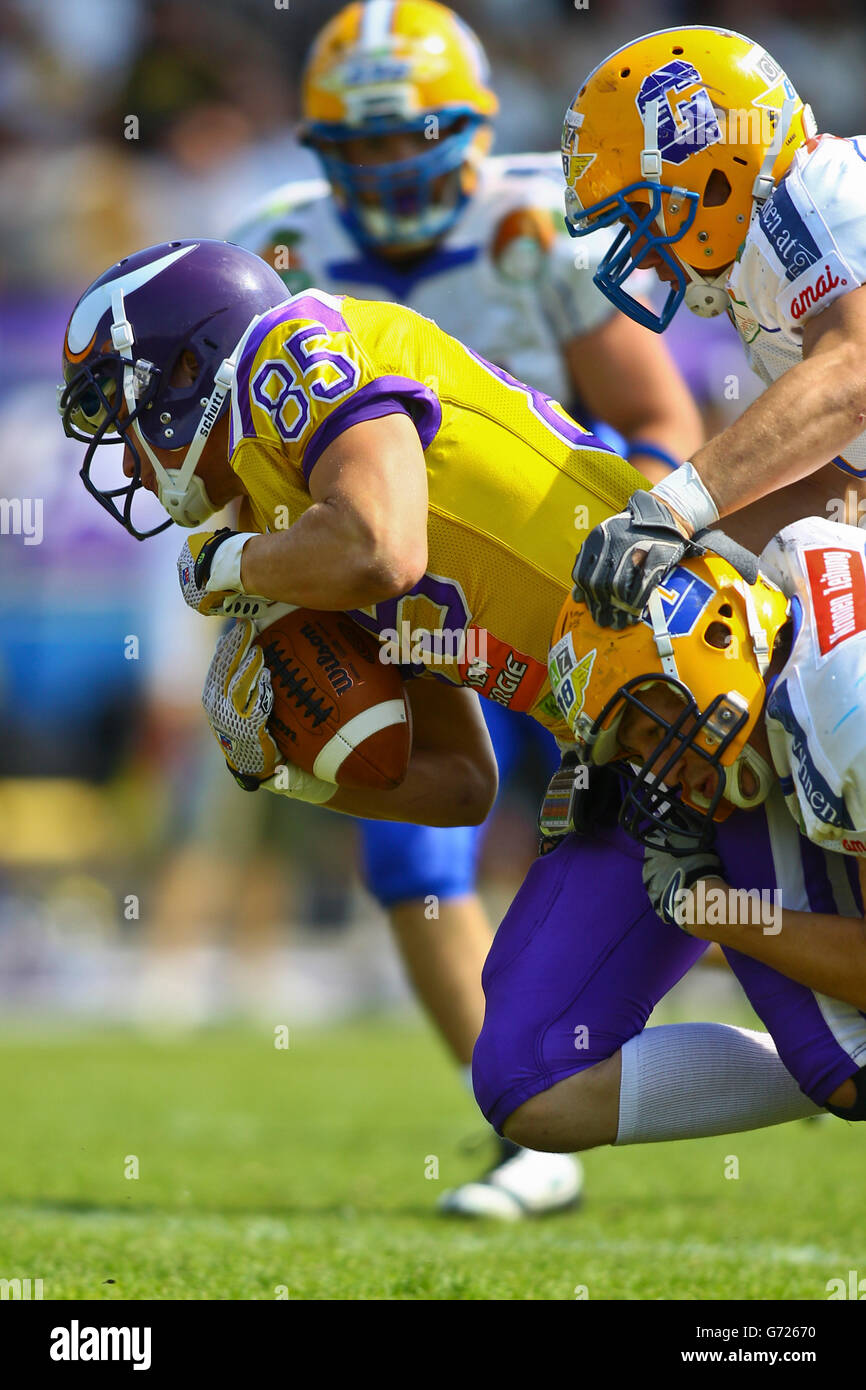 American Football, WR Valentin Schulz, No. 85 of the Vikings, being tackled; Vienna Vikings win against Graz Giants - Stock Image