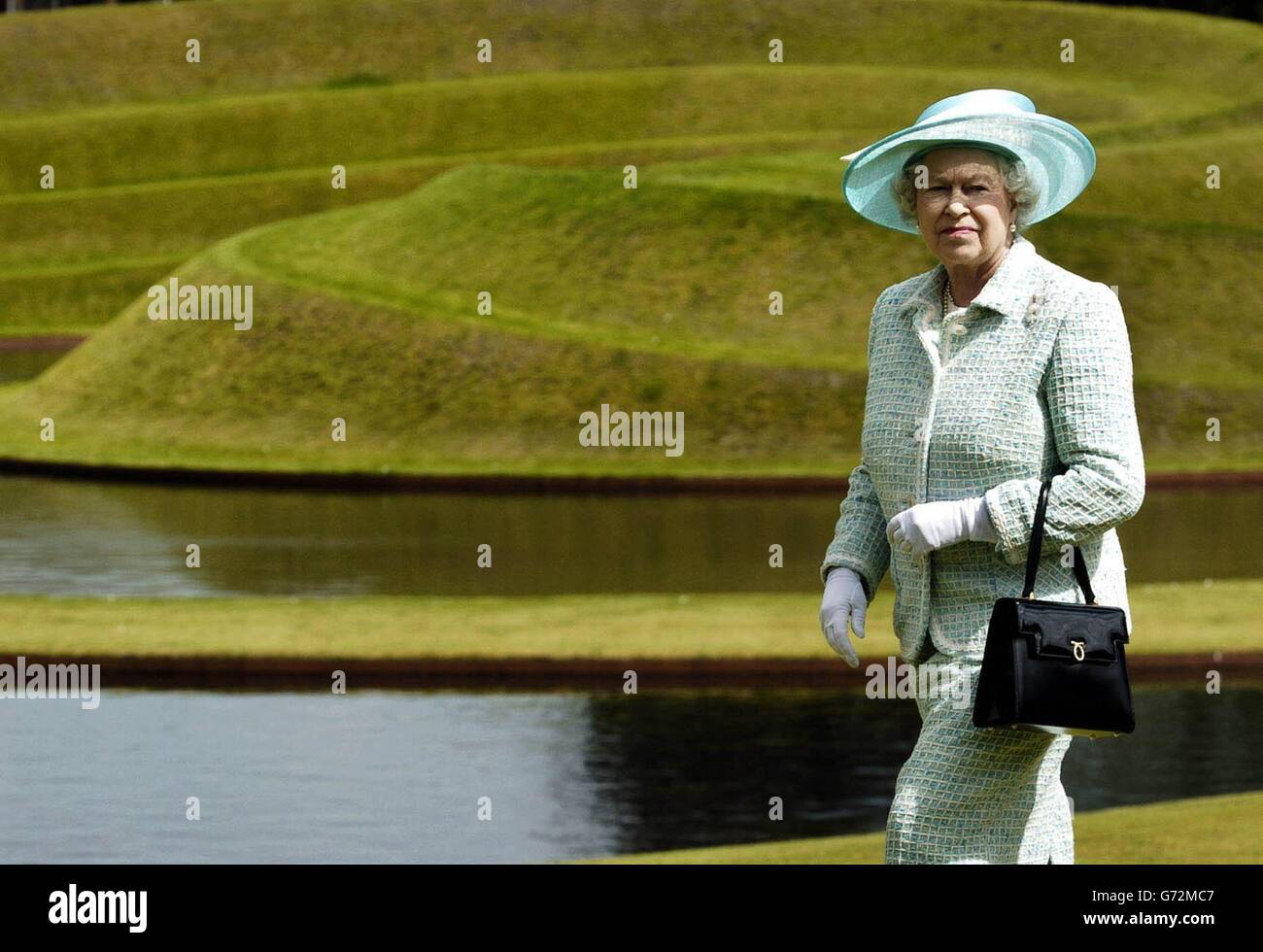 Britain's Queen Elizabeth II looks over the Landform sculpture at the Gallery of Modern Art in Edinburgh, on her last day of her week long trip to Scotland. Stock Photo