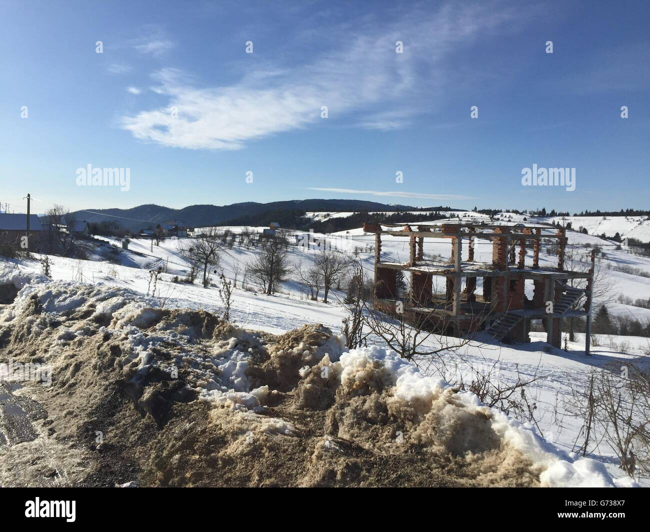 War ruins in Bosnia during Winter - Stock Image
