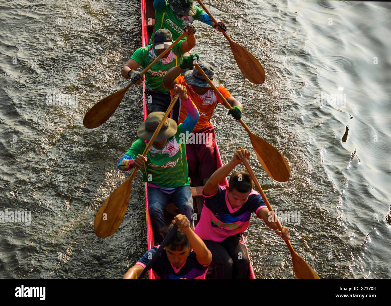 A team taking part in the Longboat racing festival held in the Thai province of Pathum Thani. - Stock Image