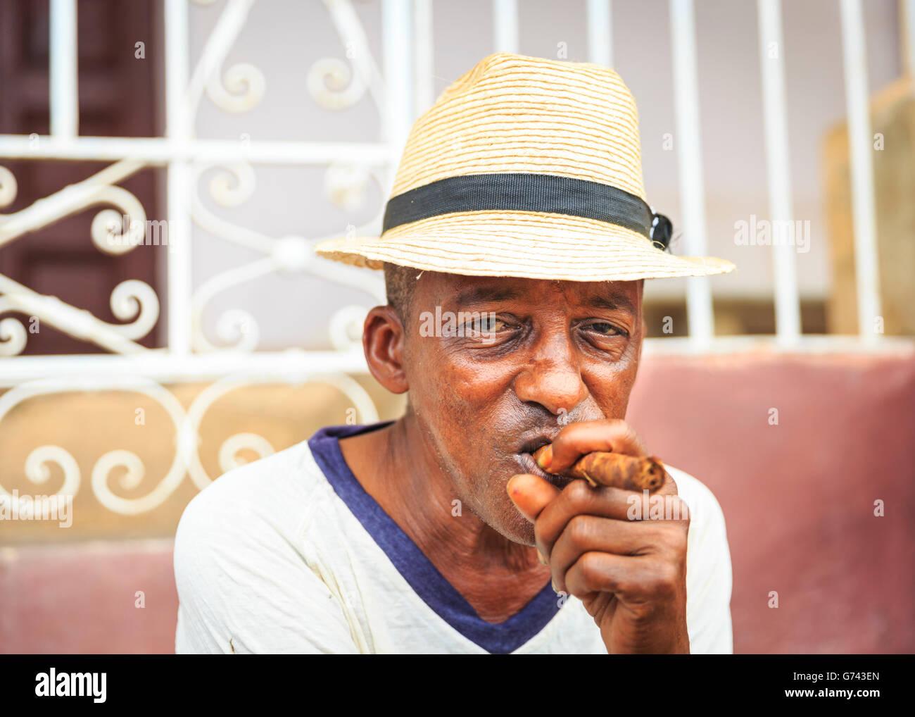 Cuban man smoking cigar c716d6df29a8