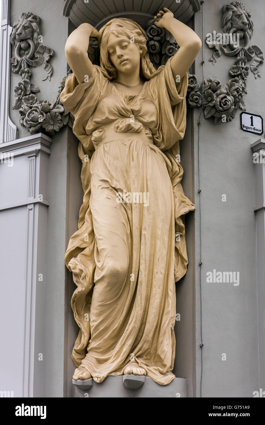 Caryatid sculpted female figure statue on the facade of a building in Tuchlauben street, Vienna, Austria - Stock Image