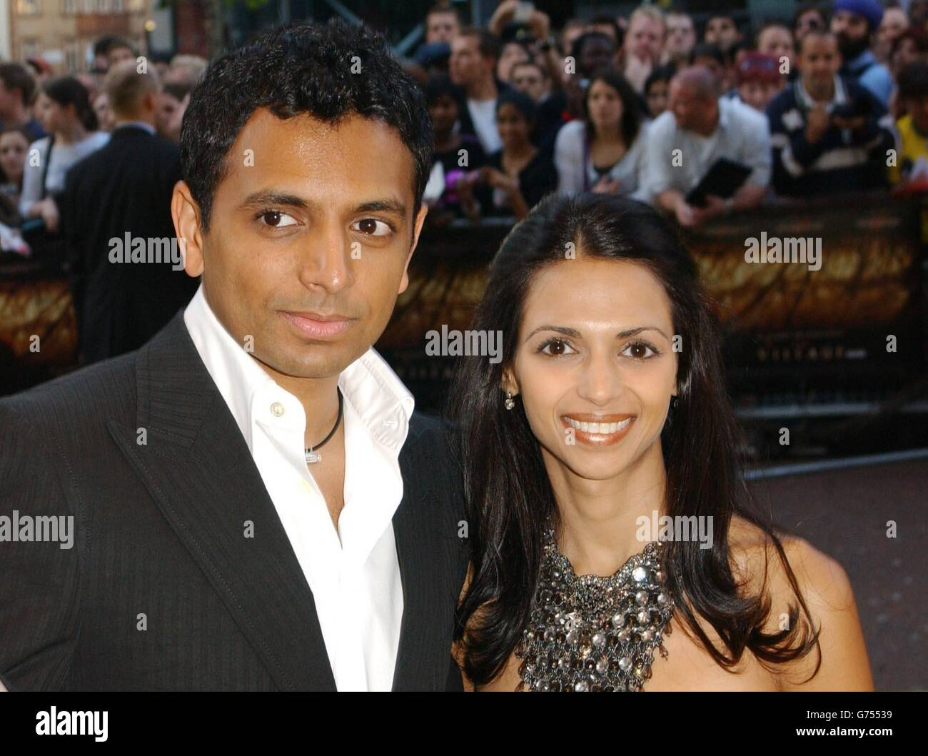 Film Director M Night Shyamalan And His Wife Stock Photos