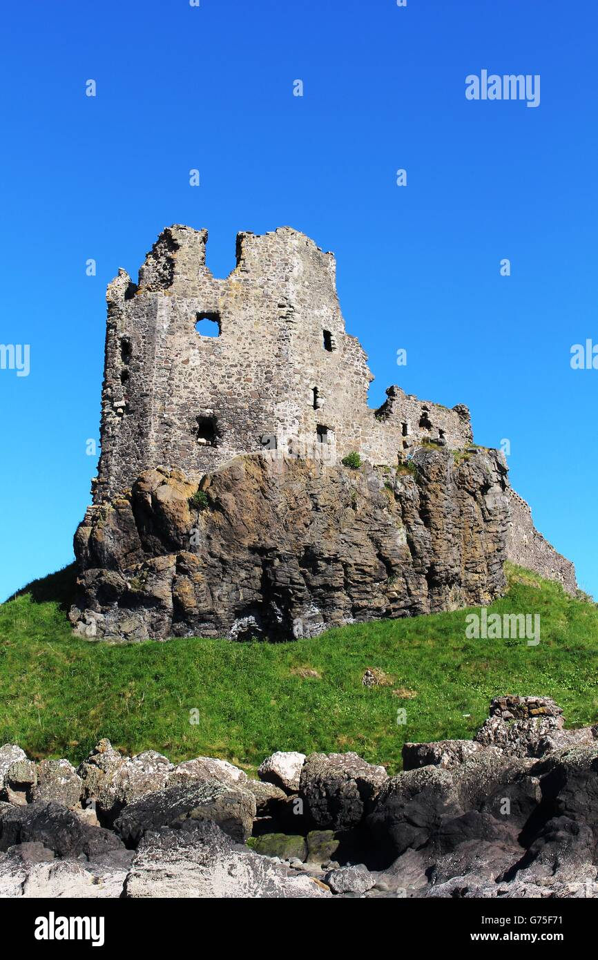 The ruins of Dunure castle on a rocky promontory on the Carrick coastline at Dunure in South Ayrshire, Scotland - Stock Image