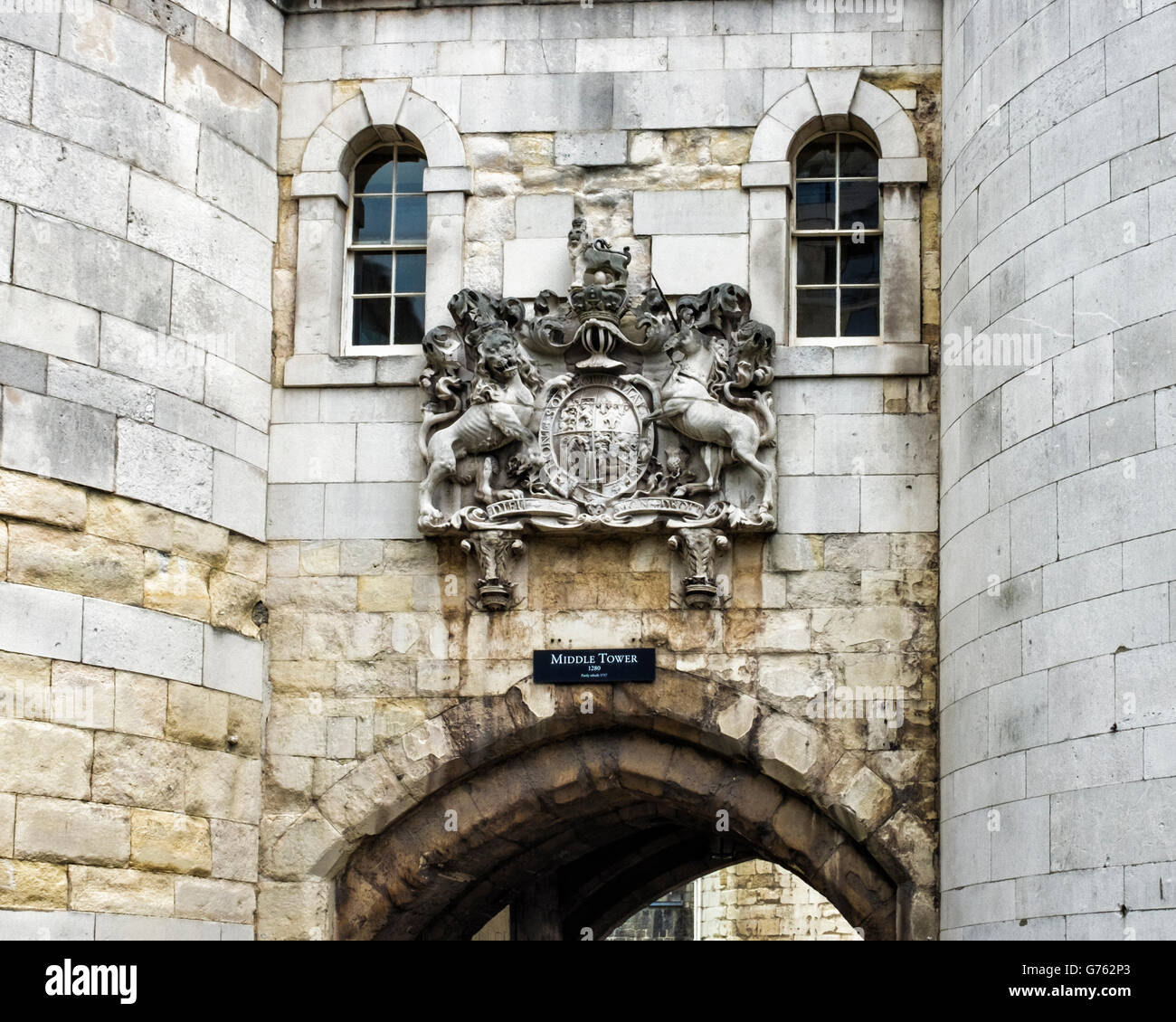 Middle tower of Tower of London. Stone Coat of Arms on historic old castle building, London, UK - Stock Image