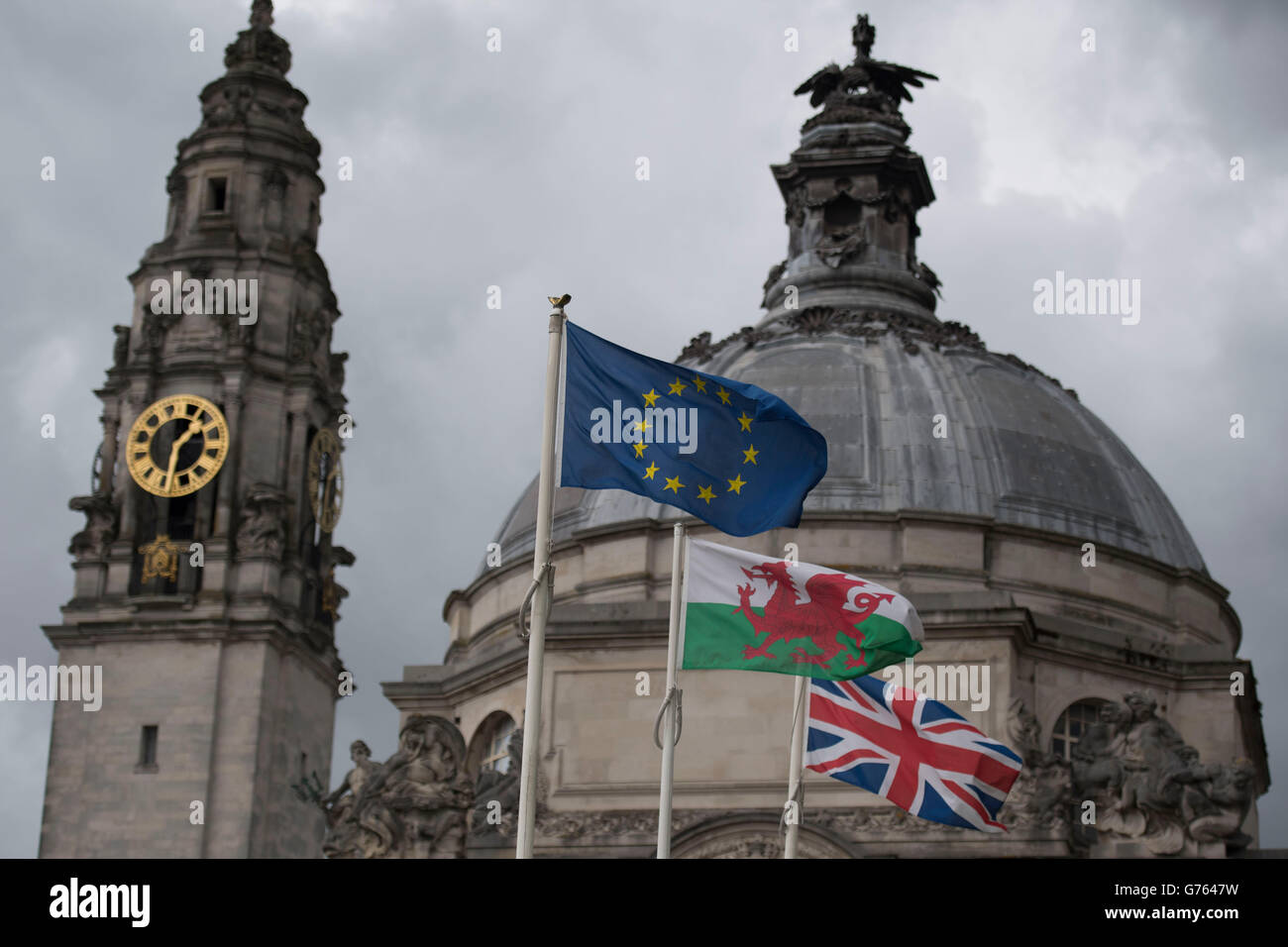 A Welsh Wales flag between a Union Jack and a European Union flag. - Stock Image