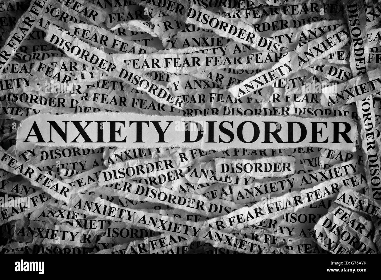 Anxiety Disorder. Torn pieces of paper with the words Anxiety Disorder. Concept Image. Black and White. Closeup. - Stock Image