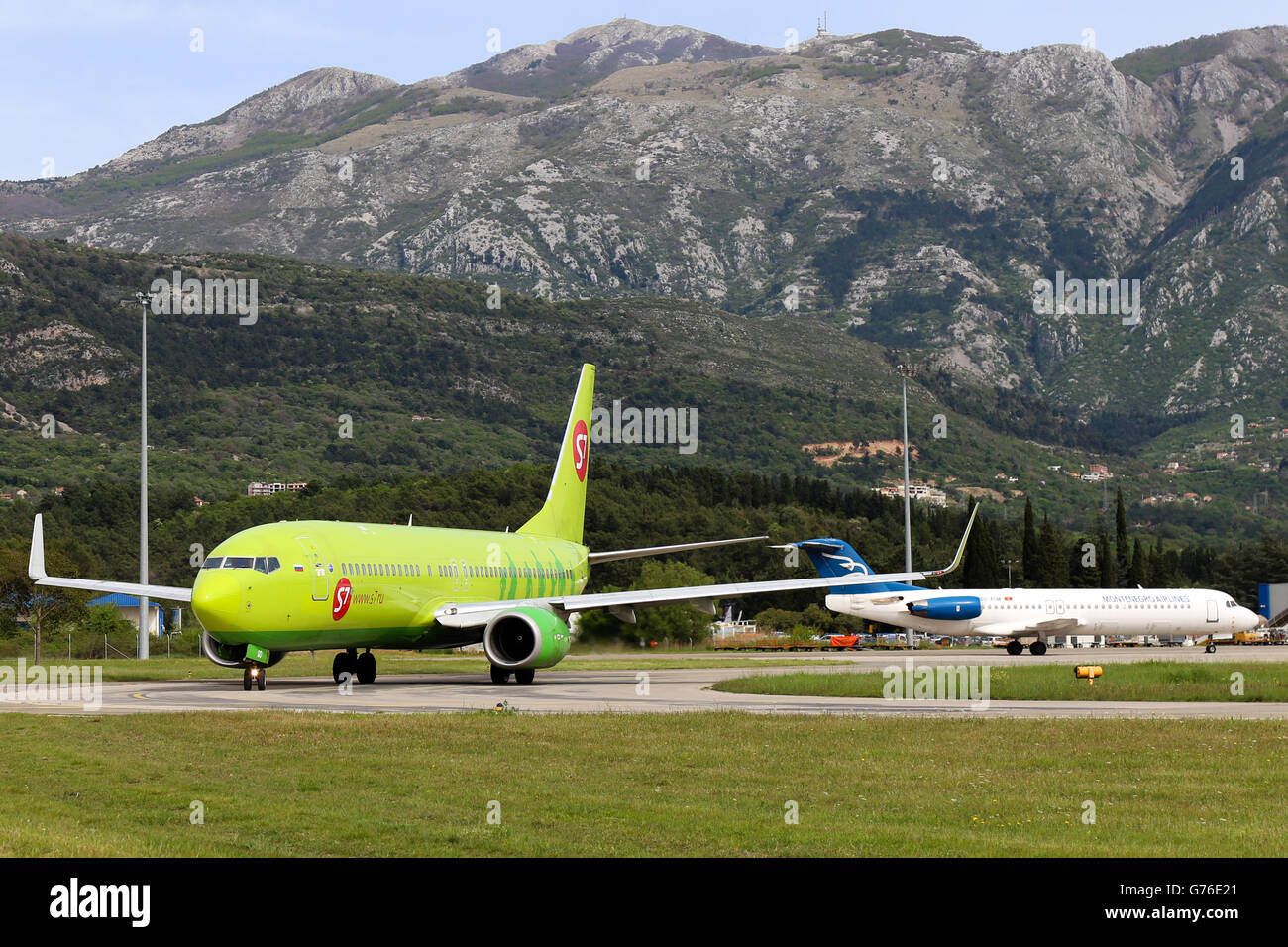 S7 Airlines Boeing 737-800 taxis to runway 14 at Tivat airport. - Stock Image