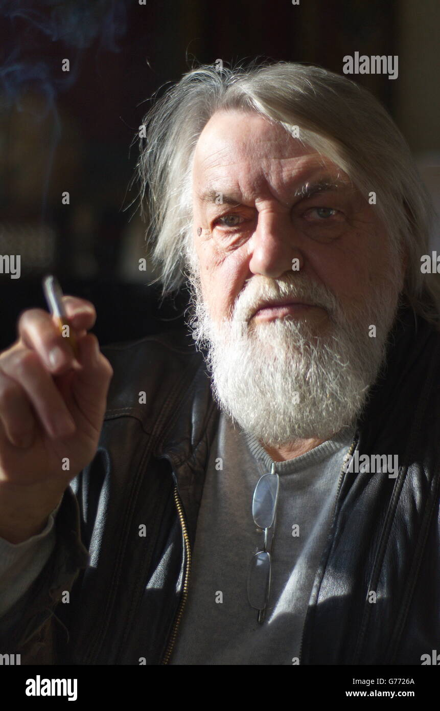 Robert Wyatt with cigarette and strong side light. - Stock Image