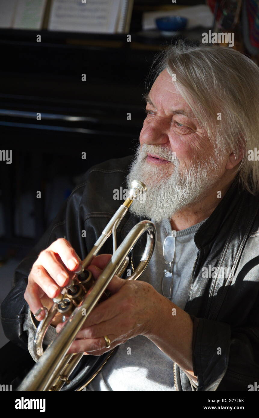Robert Wyatt with trumpet in his studio - Stock Image