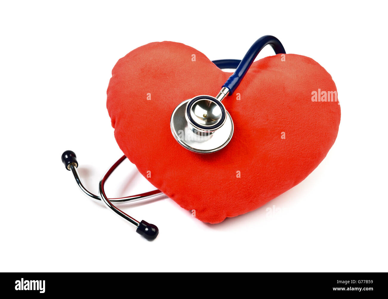 Red heart and stethoscope on white - Stock Image