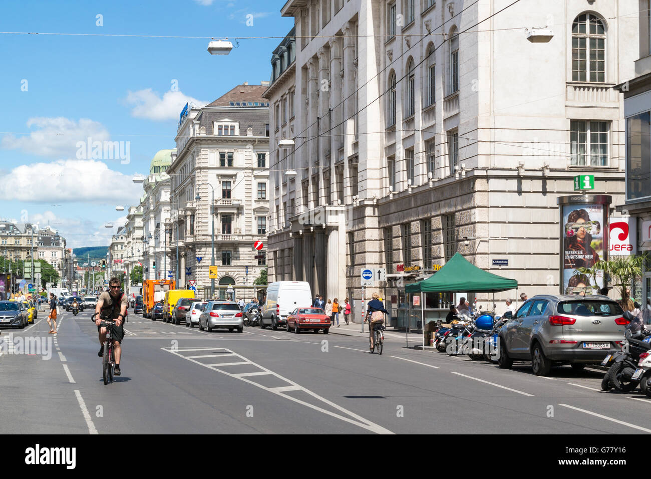 Street scene of Schottengasse with bicyclists and cars in old city centre of Vienna, Austria - Stock Image