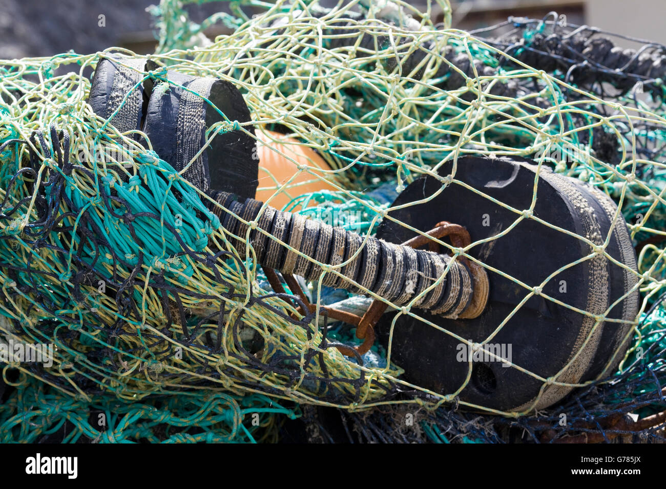 nets and flotation devices for fishing boats on the harbor Stock Photo