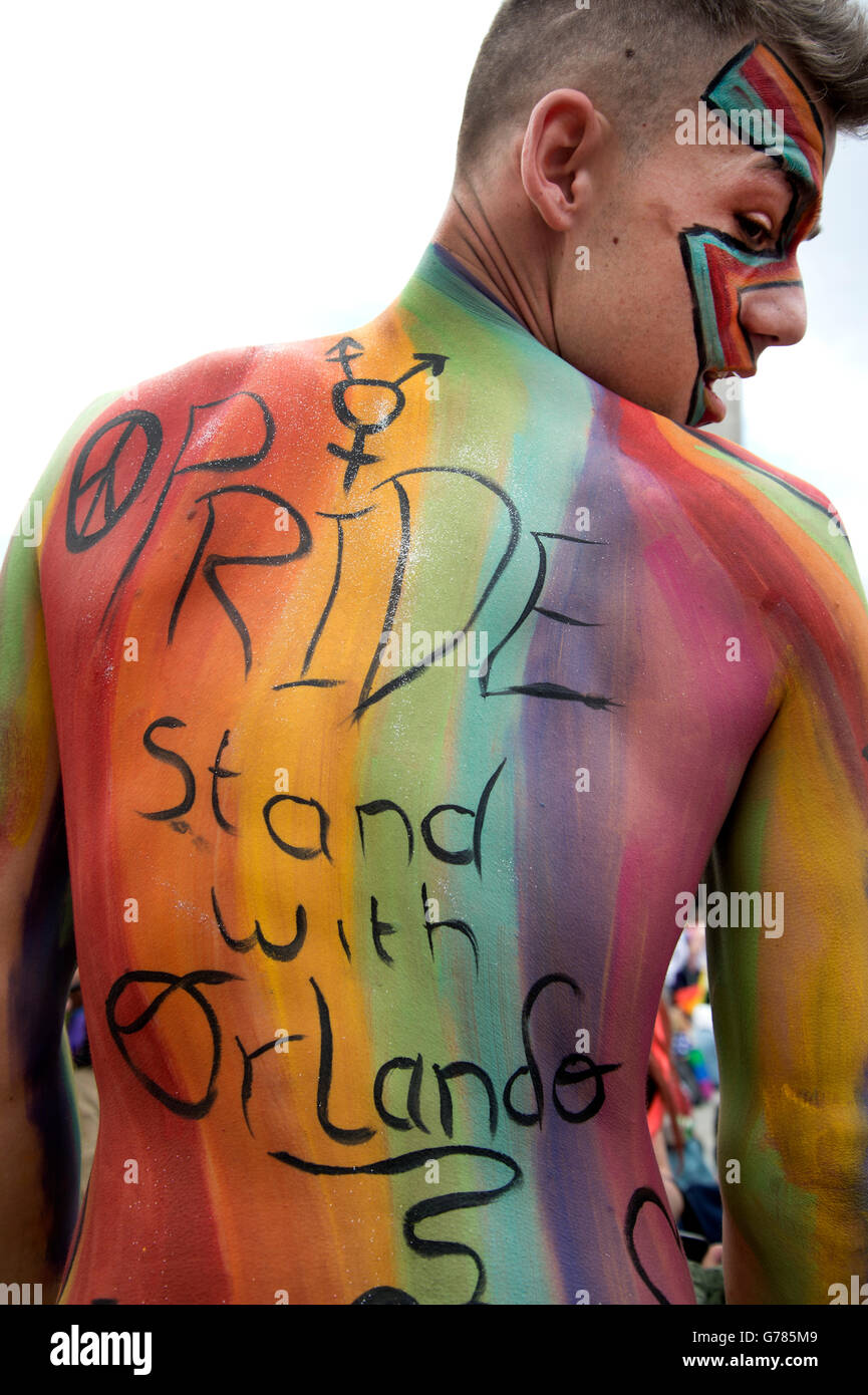 Pride in London 2016. Trafalgar Square. A young man with rainbow body paint and words saying 'Pride stand with - Stock Image