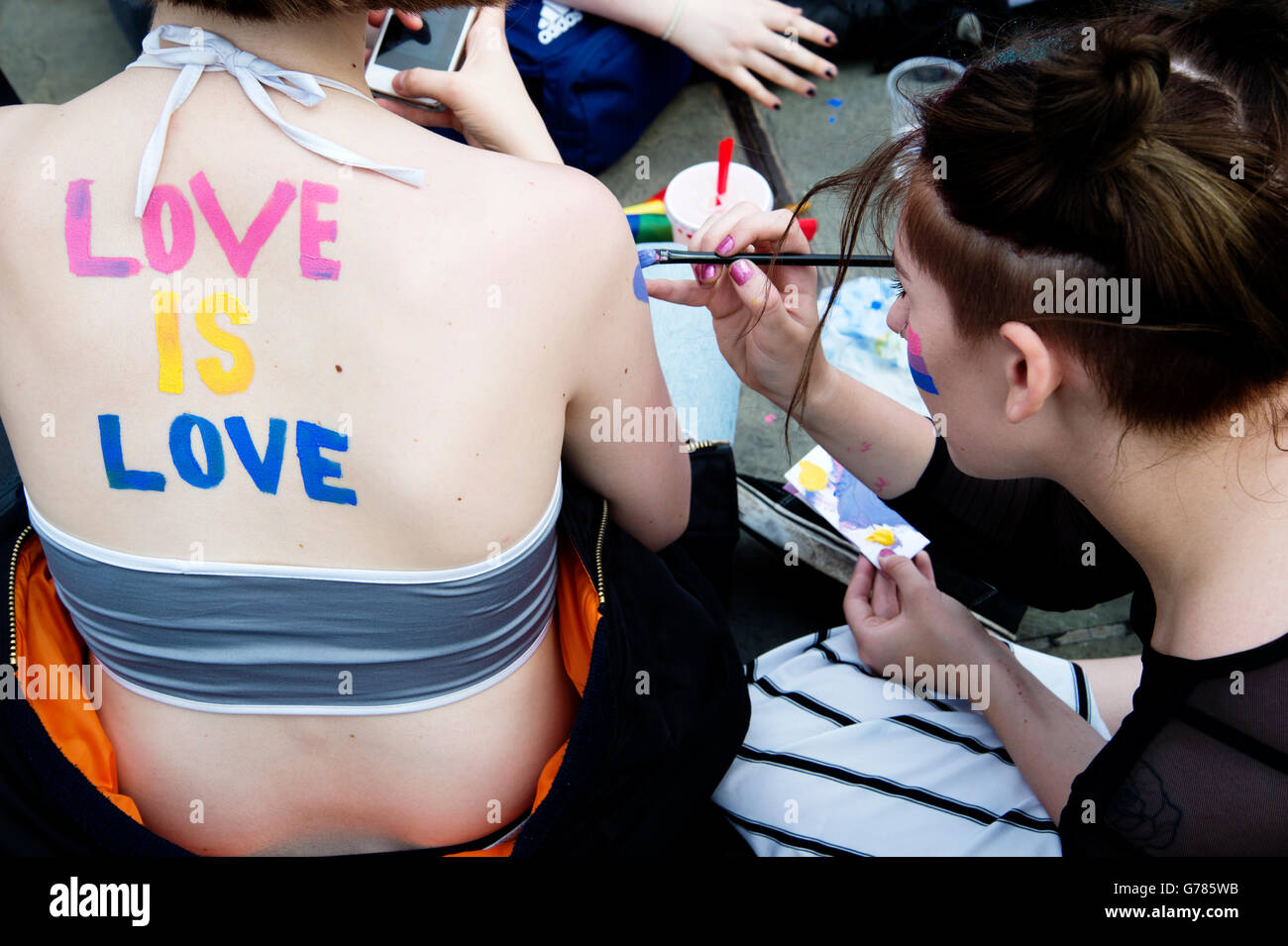 Pride in London 2016. Trafalgar Square. Body painting saying 'Love is love'. - Stock Image